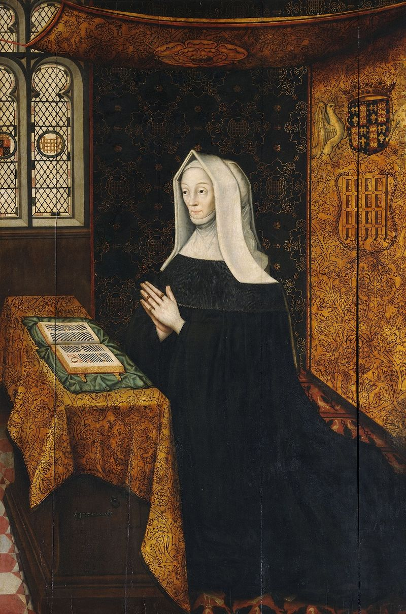 An older lady kneels in a gown and veil
