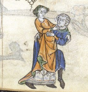 A medieval couple embrace