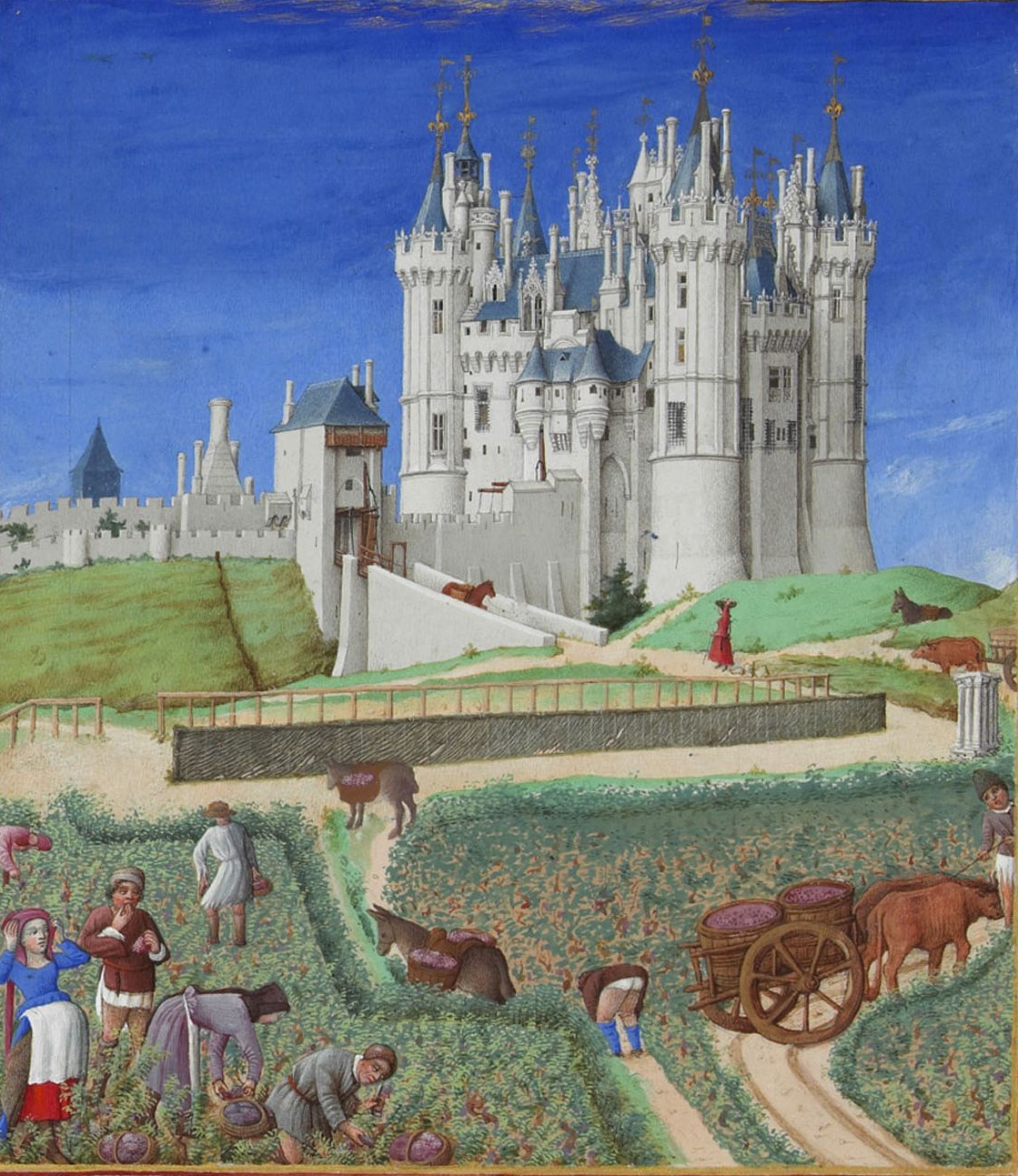 A castle stands above a vineyard of workers picking grapes