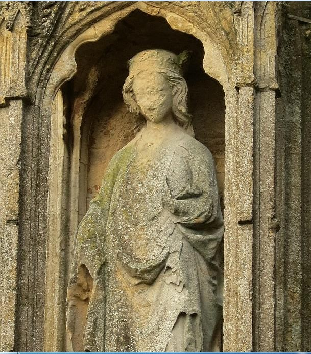 Figure of queen eleanor with significant weathering to face