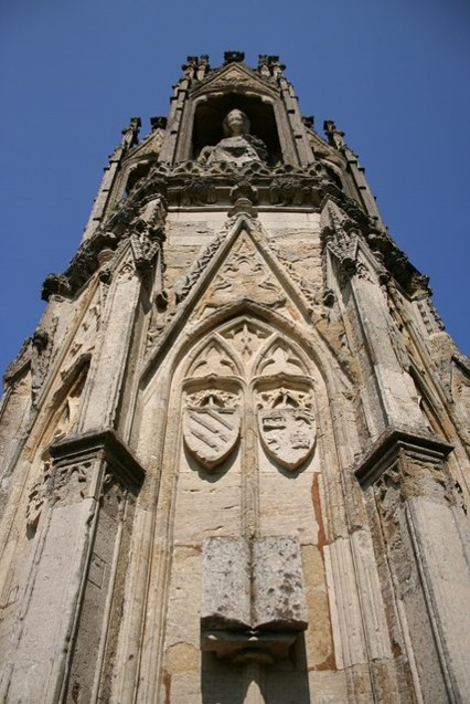 Detail of the books on the Hardingstone Cross