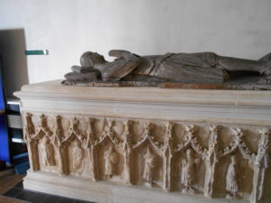 An elaborately carved tomb with effigy of a knight