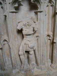 damaged stone carving with the head removed