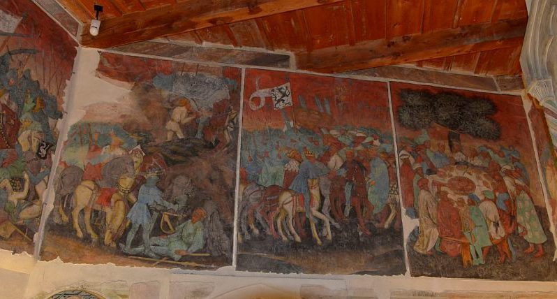 Vividly coloured mural depicting a battle