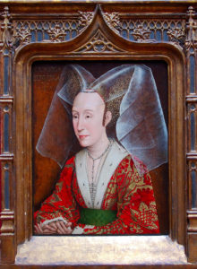 A portrait of a stern elderly lady wearing a high double-pointed hood