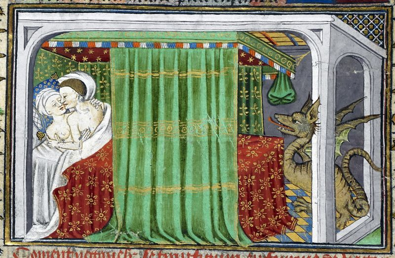 a couple embrace in bed whilst watched by a large dragon