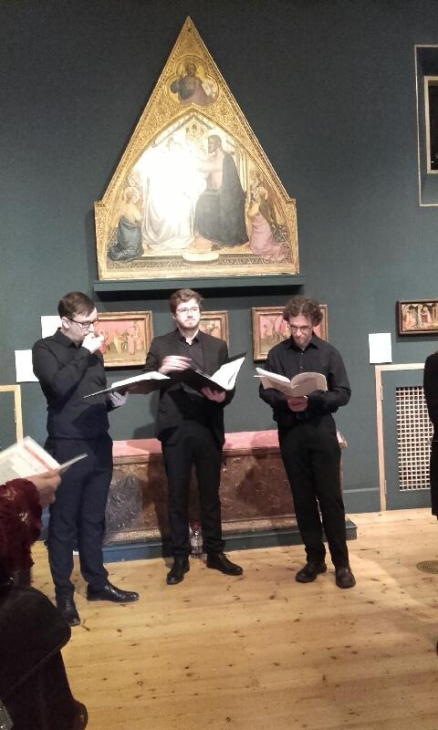 A group of singers underneath an elaborate painting