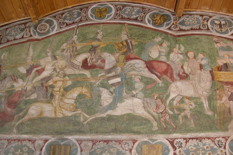 colourful fresco with jousting knights on horseback