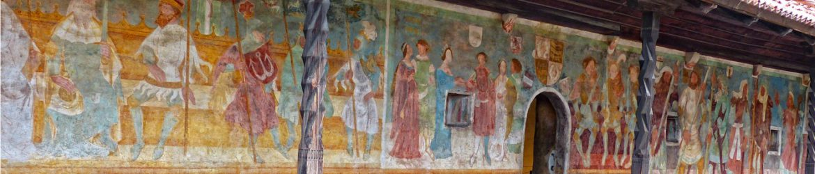 A long and well-preserved mural with many figures and rich colours