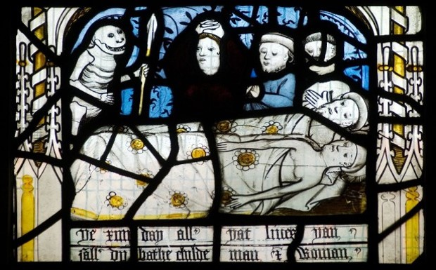 a stained glass window of a corpse with mourners